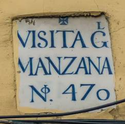 Origen azulejos edificios con texto 'Visita G Manzana'